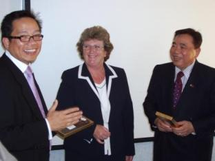 Minister Craine presents the Ambassador and the Consul Gener