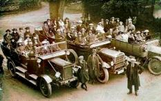 Charabancs of tourists arriving at Rushen Abbey c.1920