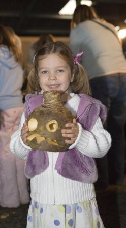 A young visitor with their turnip