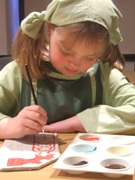 Vicky Bevis (9) painting her miniature clay replica.