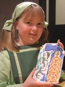Vicky Bevis (9) with her painted miniature clay replica.