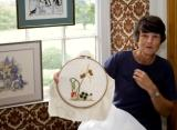 An embroiderer shows off her skills at The Grove.