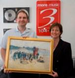 Nicola Pemberton presents 3FM with their welcom gift
