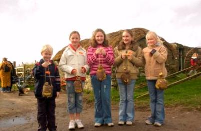 A group of children with their turnips carved ready for Hop