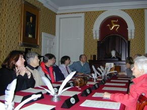 Visitors taking part in a debate at the Old House of Keys