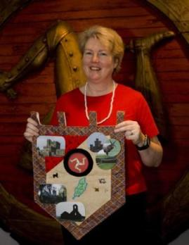 Cheryl Cheek shows of the memory quilt made at her workshop