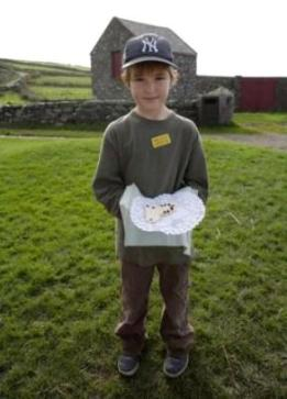 A young visitor to Cregneash shows off his hard work