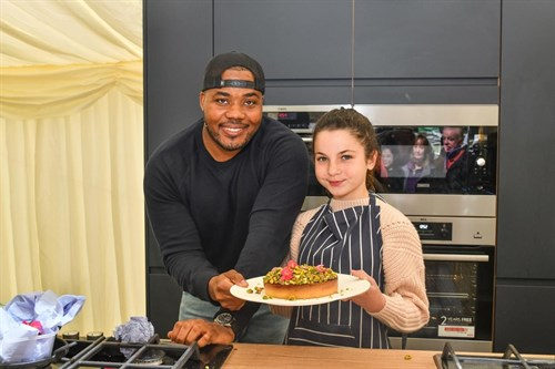 Selasi Gbormittah with little girl cooking 2019